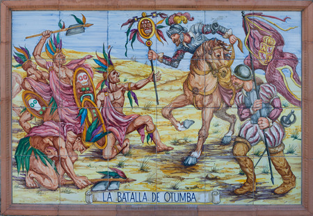 Colorful glazed tiles wall that recreates historical scenes of Badajoz town, Spain  Scenes from America conquest