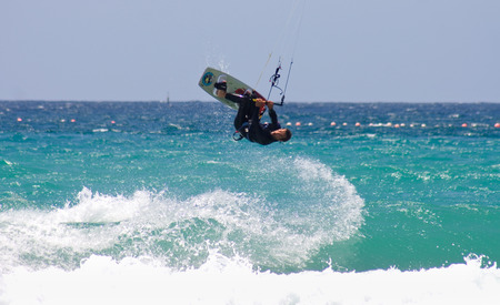 tarifa: TARIFA, SPAIN, MAY 15  Unidentified sportsman kite surfer on clean beach in summer day, Tarifa, Spain on May 15, 2009 in Tarifa, Spain Editorial