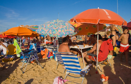vacationers: SANLUCAR, SPAIN - AUGUST 3  Vacationers in Sanlucar Beach on August 3, 2019 in Andalusia, Spain  Sanlucar is a major destination for sun and beach during horse racings season Editorial