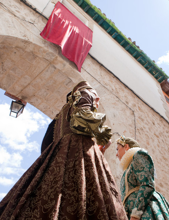 festival moment: PASTRANA, SPAIN  20 JULY  People costumed at Ducal Festival of Pastrana, Guadalajara  On july 20, 2014  Historical reenactment of XVII century, the historical moment of greatest splendor
