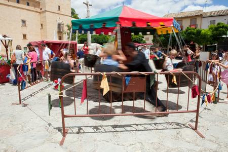 festival moment: PASTRANA, SPAIN  20 JULY  Human powered carousel at Ducal Festival of Pastrana, Guadalajara  On july 20, 2014  Historical reenactment of XVII century, the historical moment of greatest splendor