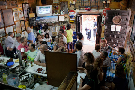 costumers: PASTRANA, SPAIN  20 JULY  Traditional bullfighting bar full of visitors during Ducal Festival of Pastrana, Guadalajara  On july 20, 2014