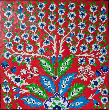iznik: Red elegant tile with motif of beautiful Iznik style flowers, traditional Turkish-Ottoman art