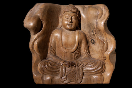 ancient philosophy: Wooden Figurine Of Meditating Buddha Isolated. Carved