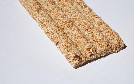 gozinaki: Honey bars with sesame seeds on white background
