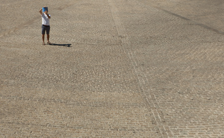 plaza: Unidentified man photographing the Plaza Mayor of Trujillo with his tablet