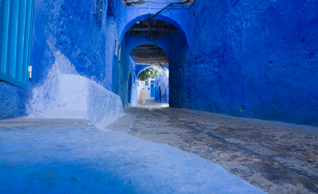 Unrecognizable natives on traditional moroccan architectural details in Chefchaouen, Morocco, Africa  photo