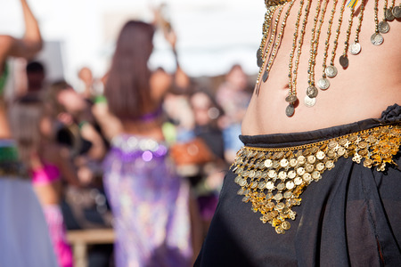 Belly dancers detail dancing with arabic music street band at the Almossasa Festival, Marvao, Portugal Stock Photo
