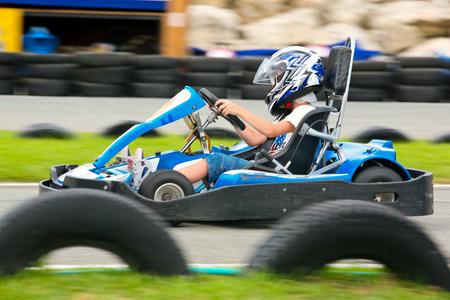 Unrecognizable people having fun on a go cart. Summer season 免版税图像
