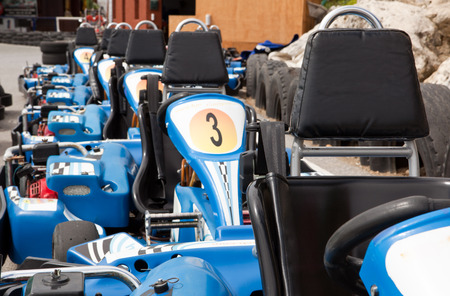 Machine karts before the start on the circuit. Parked on line photo