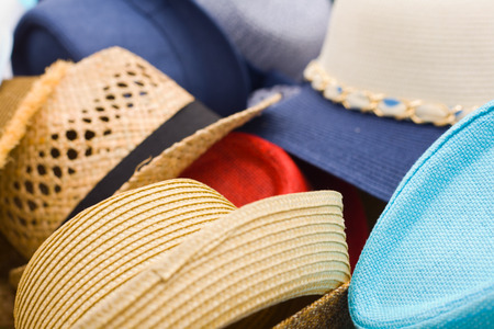 street market: Lots of ladies and gentlemen hats ready for sell on an street market stall Stock Photo