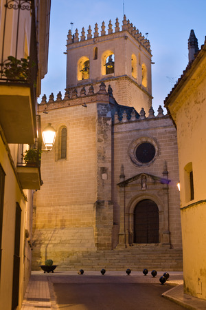 badajoz: Saint John the Baptist Cathedral San Juan belltower between old town streets at dusk