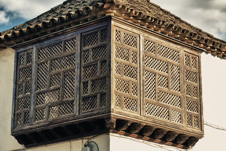 Traditional architecture in of the famous city Cordoba in Spain. Wooden  latticework Balcony Cordoba, Andalusia, Spain