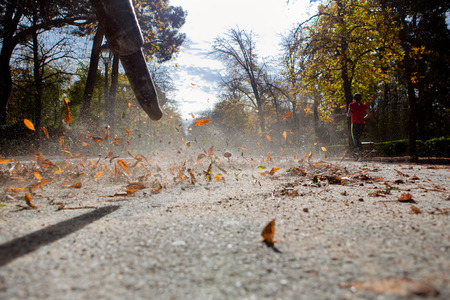 Worker in autumn with a leaf blower. Retiro park, Spain Stock fotó