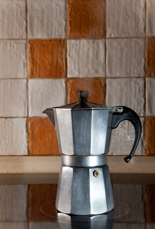 steam jet: Steaming expresso coffee maker at work isolated over white and brown glazed tile wall