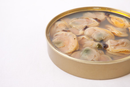 tinned goods: Chilean clams in a tin can. Isolated on white. Selective focus