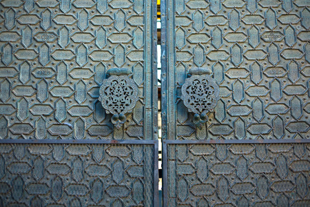 doorknocker: Doors of the mosque at  Cordoba. Andalusia, Spain. Doorknocker detail Stock Photo
