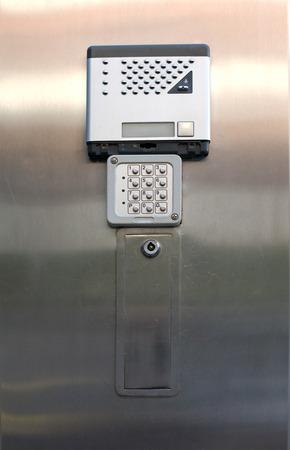 dial lock: Alarm keypad and intercom isolated over metallic background