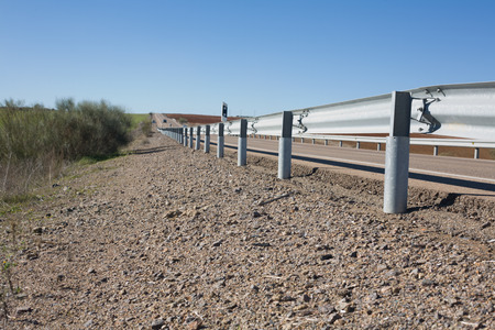 guard rail: Rail guards on the road covered by cylindrical pipes in order to avoid amputations at motorbikers falls