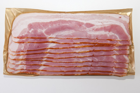 Bacon slices on the package, isolated on white background
