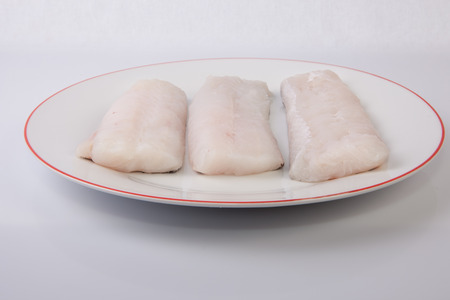 hake: Boneless hake steaks. Isolated over white background