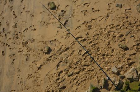 implanted: Fishing rod standing on spanish beach, Huelva