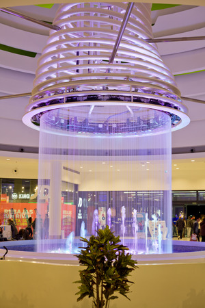 drop ceiling: SPAIN - JANUARY 21, 2015: People shopping around the ceiling fountain with lights in the mall El Faro on January 21, 2015 in Badajoz, Spain
