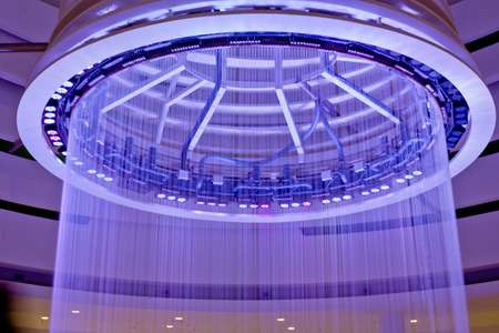 drop ceiling: Ceiling fountain with violet lights in the mall Stock Photo
