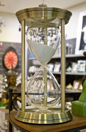 shelve: Metallic sand hourglass over a store shelve