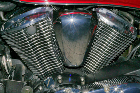 cilinder: Old metal chromed red motorbike engine with shinnings Stock Photo