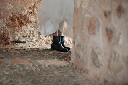 combat boots: Caucasian bride with her black combat boots.
