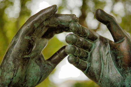 faithfulness: Sculpture of two hands falling in love, Cordoba, Spain Stock Photo