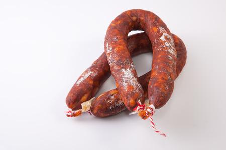 chorizos: Two red spanish chorizos. Isolated over white background
