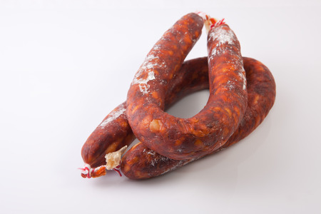 chorizos: Two red spanish chorizos. Isolated over white background