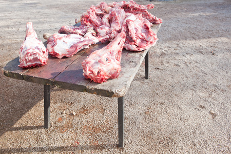 slaughtering: Pieces of pig over wooden table. Traditional home slaughtering in a rural area, Extremadura, Spain Stock Photo
