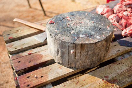 slaughtering: Stump tree for cutting the meat. Traditional home slaughtering in a rural area, Extremadura, Spain