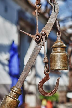 farm house: Hanging antique roman steelyard on a farm house, Badajoz, Spain