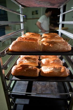 artisan bakery: Racks of freshly baked neapolitan cakes