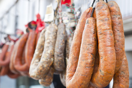 chorizos: Blood sausages and chorizos hanging over street market stall