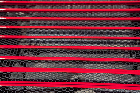 red sports car: Red sports car engine grid. Detail of a luxury car Stock Photo