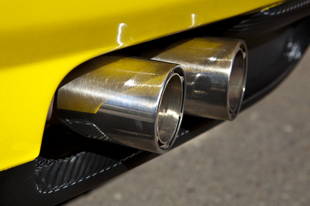 car exhaust: Sports car exhaust pipe with two chromed tubes. Selective focus