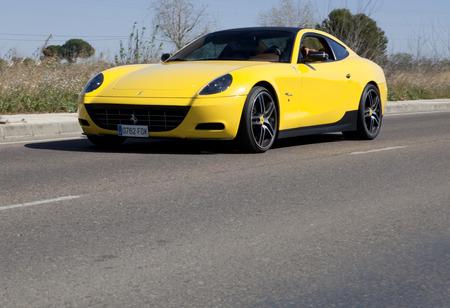 badajoz: BADAJOZ, SPAIN - MARCH 14, 2015: Ferrari Car show at Badajoz City on Complejo Alcantara resorts, March 14, 2015. Yellow Ferrari on the road