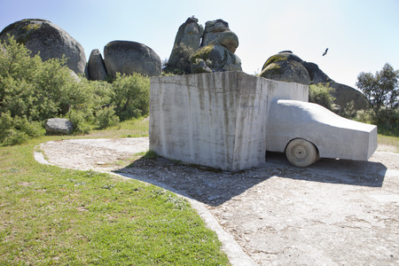 in the open air: MALPARTIDA, SPAIN, APRIL 7, 2015: Open air sculpture titled VOAEX at Los Barruecos Natural Park, belong to Wolf Vostell artist