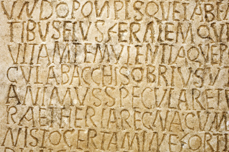Latin writing carved on the tombstone. Closeup Stock fotó