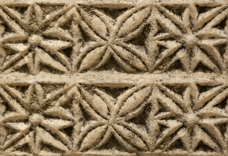 pilaster: Marble carved with geometrical drawings from visogoth pilaster. Closeup over black background Stock Photo