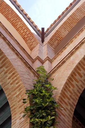 mudejar: Mudejar architecture detail. Corner of courtyard with plants