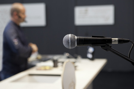 haute cuisine: A cooker gives a haute cuisine course with a microphone in the foreground