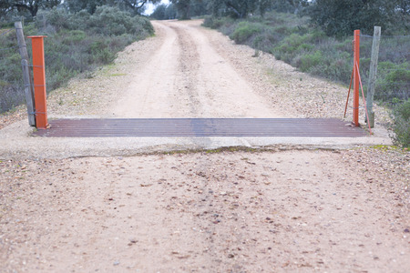 cattle grid: A cattle grid in a dirt track at dehesa landscape Extremadura Spain