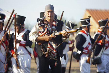 blunderbuss: BADAJOZ SPAIN  MAY 9: Reenactment of Albuera battle between French and allied nations armies in 1811. May 9 2015 in La Albuera Badajoz Spain. Spanish bandit or bandolero fighting between allied troops