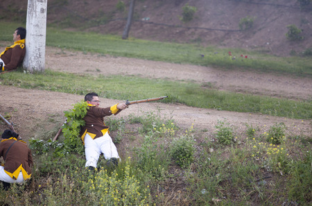 musket: BADAJOZ SPAIN  MAY 9: Reenactment of Albuera battle between French and allied nations armies in 1811. May 9 2015 in La Albuera Badajoz Spain. Wounded soldier firing musket